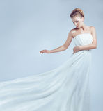 Bride in white dress flying royalty free stock photo