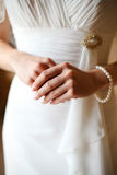 The bride in a white dress, hand and fingers Stock Photo