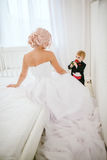 Bride in white dress and her son Stock Images