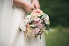 Bride in white dress holding bouquet Royalty Free Stock Images