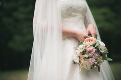 Bride in white dress holding bouquet Royalty Free Stock Photo