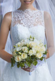 Bride in White Dress Holding Splendid Bridal Boquet. Colorful Royalty Free Stock Photo