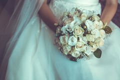 Bride in White Dress Holding Splendid Bridal Boquet. Colorful Stock Photo