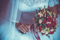Bride in White Dress Holding Splendid Bridal Boquet. Colorful Stock Photography