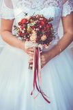 Bride in White Dress Holding Splendid Bridal Boquet. Colorful Royalty Free Stock Image