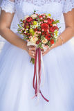 Bride in White Dress Holding Splendid Bridal Boquet. Colorful Royalty Free Stock Photography
