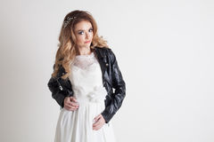 Bride in white dress and leather jacket Stock Images
