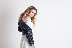 Bride in white dress and leather jacket Stock Photos