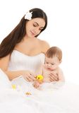 Bride in white dress with little baby Royalty Free Stock Photo