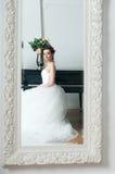 Bride in white dress in mirror. Wedding Stock Photos