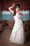 Bride in white dress posing Royalty Free Stock Image