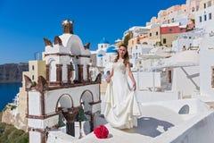 Bride in white dress on Santorini Stock Images