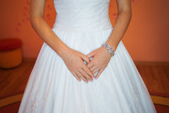 Bride in white dress standing in the room Stock Image