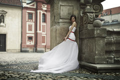 Bride in a white dress on the street stock images