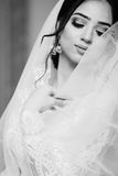 Bride in white dress and veil