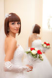 The bride in a white dress with a wedding bouquet Royalty Free Stock Photography