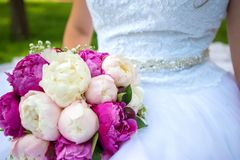 Bride in a white dress with a wedding bouquet. details. Bride in a white dress with a wedding bouquet Royalty Free Stock Image
