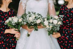 bride in a white lace dress and two girls royalty free stock photography