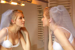 Bride in white lingerie looking  in the mirror Royalty Free Stock Images
