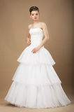 Bride in White Long Dress Posing in Studio. Caucasian Woman in White Long Dress Posing in Studio Stock Photos