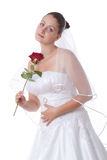 Bride in white with red rose Stock Image