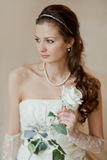 Bride with a white rose Royalty Free Stock Photo