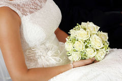 Bride with white rose bouquet Royalty Free Stock Photography