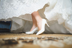 Bride in White Shoes Stock Images
