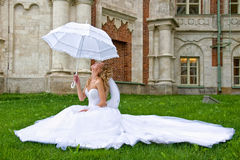 Bride with white umbrella Royalty Free Stock Image