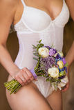 Bride in a white underwear with a wedding bouquet Stock Photography