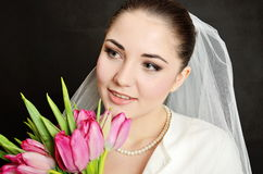 Bride with white veil and flowers Stock Photography