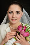 Bride with white veil and flowers Stock Photos