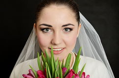 Bride with white veil and flowers Stock Images