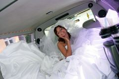 Bride in white wedding dress. Smiling beautiful bride in traditional white weddiing dress Royalty Free Stock Photography