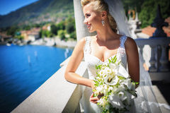 Bride. In white wedding dress with a bouquet Stock Photos
