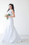 Bride in white wedding dress with a bouquet of flowers Stock Photo