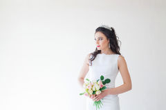 Bride in white wedding dress with a bouquet of flowers Stock Photography
