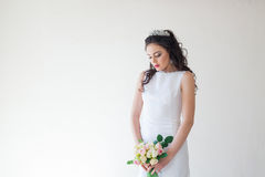 Bride in white wedding dress with a bouquet of flowers Royalty Free Stock Photos
