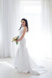 Bride in white wedding dress with a bouquet of flowers Stock Photos