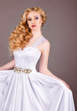 Bride in white wedding dress on a gray background. Royalty Free Stock Images