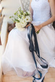 Bride in white wedding dress holding a bouquet of  flowers Stock Images
