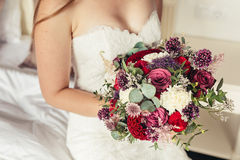 Bride in white wedding dress holding lilac wedding bouquet  Stock Image