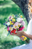 Bride in white wedding dress holding wedding bouquet. Stock Images