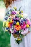 Bride in white wedding dress holding wedding bouquet. Royalty Free Stock Photos