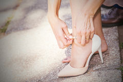 Bride who closes his shoes Stock Photo