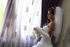 Bride at the window Stock Image
