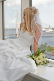 Bride on the window Stock Images