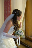 The bride at a window Royalty Free Stock Images