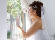 Bride in window Stock Photos