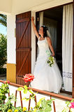 Bride at window. Bride leaving parent´s home . Portrait of a bride outside window Stock Images